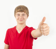 Boy shows thumbs up Stock Photography