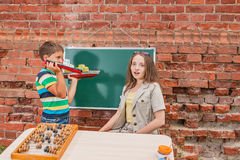 The boy shows to the young teacher the ships Royalty Free Stock Photos