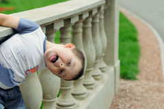 Boy shows tongue Royalty Free Stock Images