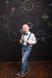 Boy shows tongue, teasing and fun. Boy show tongue, teasing and fun royalty free stock photography