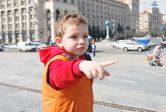 The boy shows the way Stock Images