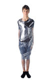 Boy shrinkwrapped on cellophane Royalty Free Stock Photo