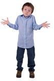 Boy shrugging Royalty Free Stock Photo