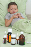 The boy is sick. Holding a cup and do not want to drink Royalty Free Stock Image