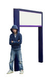 Boy with Sign. An isolated image for ease of use, of a teen thug looking menacing, leaning against a blank signpost stock image