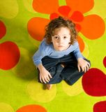 Boy siiting on colorful carpet Royalty Free Stock Photos
