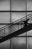 Boy silhouette climbing stairs Royalty Free Stock Photos