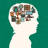 Boy silhouette with education icons Royalty Free Stock Image