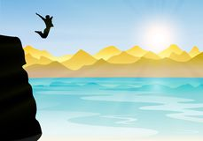Boy silhouette jumping from cliff to the sea Stock Image