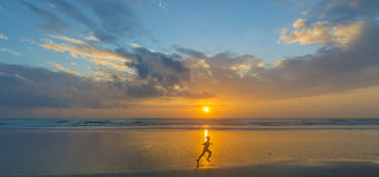 Boy silhouette and sunrise. Silhouette of children running with sunrise background Royalty Free Stock Photography