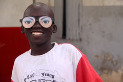Boy with Silly Glasses in Dakar. A Senegalese boy in Dakar has fun with a pair of silly glasses on his Tabaski holiday (Muslim festival of Eid-al-Adha Stock Photo