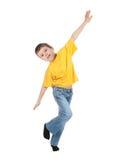 Boy simulates flight Stock Images