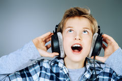 Boy singing Stock Images