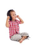 Boy singing and crooning. Boy with headphones singing along - isolated on white with a bit of shadow royalty free stock photo