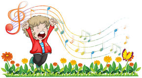 A boy singing at the garden Royalty Free Stock Image