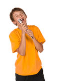 Boy singing karaoke. Isolated on white background Royalty Free Stock Image