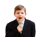 Boy singing in a karaoke. Isolated on white Stock Photos