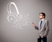 Boy singing and listening to music Stock Photos