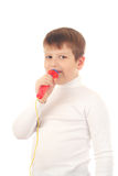 Boy singing in a microphone Royalty Free Stock Photos