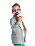 Boy singing with a microphone. Handsome happy boysinging with a microphone - isolated on white background Royalty Free Stock Photo