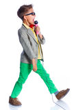 Boy singing with a microphone Stock Image