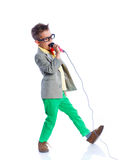 Boy singing with a microphone. Handsome happy boysinging with a microphone - on white background Royalty Free Stock Images