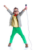 Boy singing with a microphone. Handsome happy boysinging with a microphone - on white background Royalty Free Stock Photos