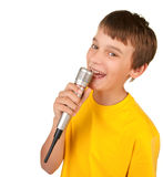 Boy singing into microphone isolated. Boy singing or speaking into microphone isolated white stock photos