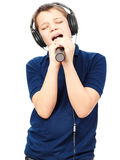 Boy singing into a microphone. Very emotional. Stock Images