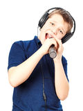 Boy singing into a microphone. Very emotional. Stock Photography