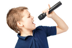 Boy singing into a microphone. Very emotional. Teenage boy singing into a microphone on a white background. Very emotional royalty free stock photo