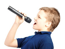 Boy singing into a microphone. Very emotional. Teenage boy singing into a microphone on a white background. Very emotional stock photo