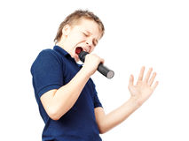 Boy singing into a microphone. Very emotional. Stock Image