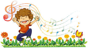 A boy singing out loud with musical notes Stock Photos
