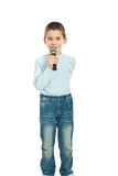 Boy singing to microphone royalty free stock images