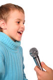 Boy sings into microphone Stock Photos