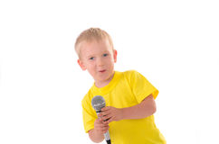 Boy sings with microphone Stock Images