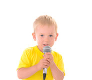 Boy sings with microphone Stock Photo