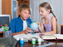 Boy and sister studying with books Royalty Free Stock Image