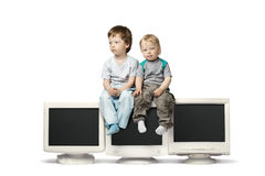 Boy sit on CRT monitor. Isolate on white Stock Image