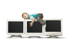 Boy sit on CRT monitor. Isolate on white Royalty Free Stock Photos