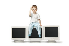 Boy sit on CRT monitor. Isolate on white Stock Images