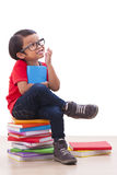 Boy sit and holding Royalty Free Stock Photos