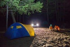 Boy sit at night tourists tent. Stock Photo