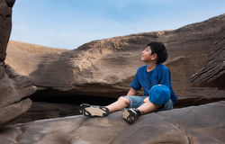 Boy sit relax on stone Royalty Free Stock Images