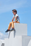 Boy sit on top of a sculpture at Museum Square, Amsterdam, Netherlands Royalty Free Stock Photography