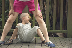 Boy sit under legs Royalty Free Stock Images