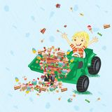 Boy siting in tractor with candies. Stock Photos