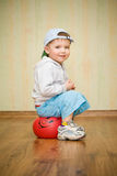 Boy sits on a ball Stock Photos