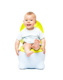 The boy sits on a chamber pot. The boy on a chamber-pot Stock Photo